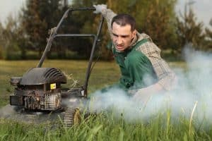 white smoke lawn mower