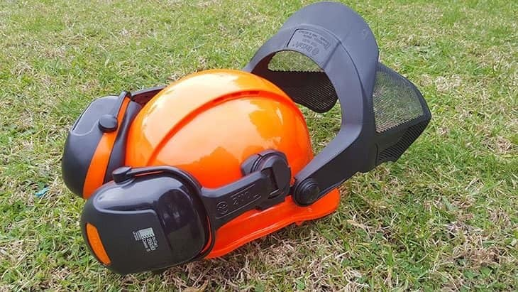 chainsaw helmet on grass