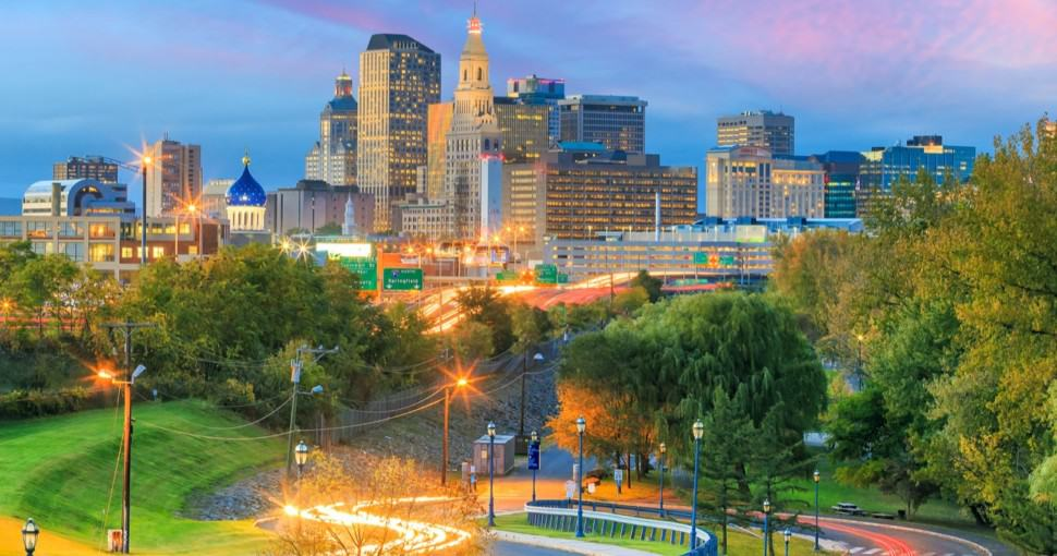 Skyline of downtown Hartford Connecticut from above Charter Oak Landing at sunset
