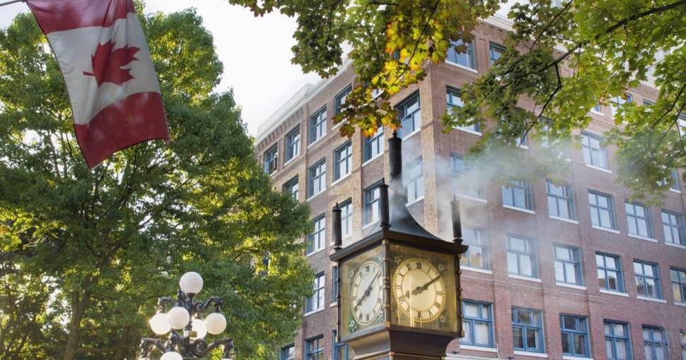 Steam Clock at Gastown Vancouver BC Canada surrounded by Maple trees
