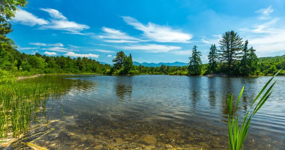 Coffin Pond in New Hampshire with the White Mountain Range in the background