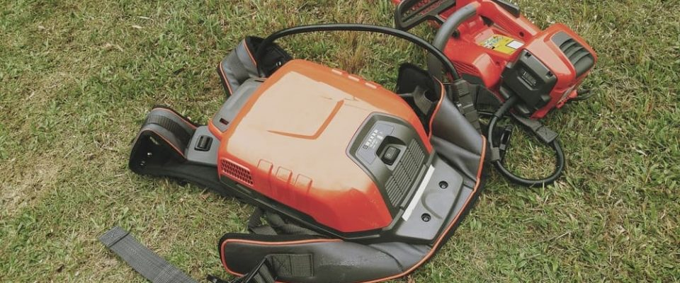 battery powered chainsaw with external backpack battery